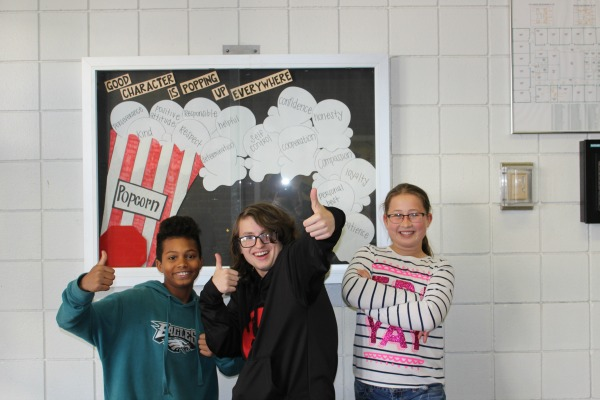 Winners of the second annual Parnassus Halloween writing contest are (from left - right) Blake Sinks (2nd place), Cooper Dale (1st place), and Ella Hudson (3rd place).