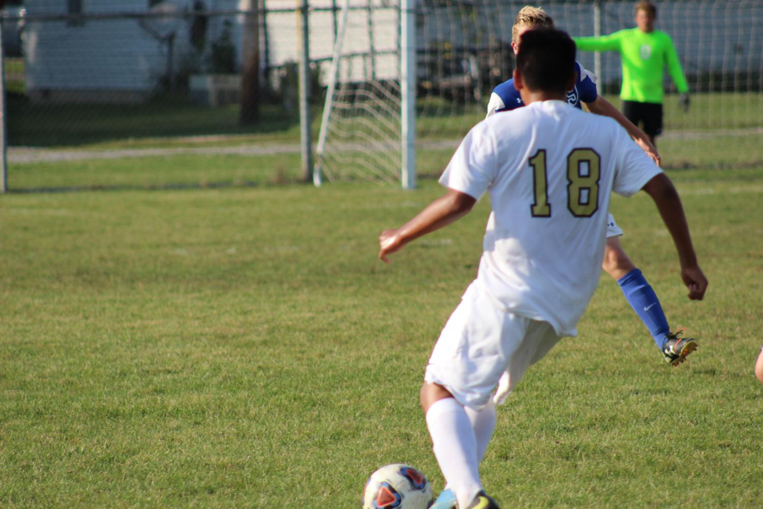 Freshman Ricky Martinez takes on a Carroll defender. Photo taken by Michael O'Neil.