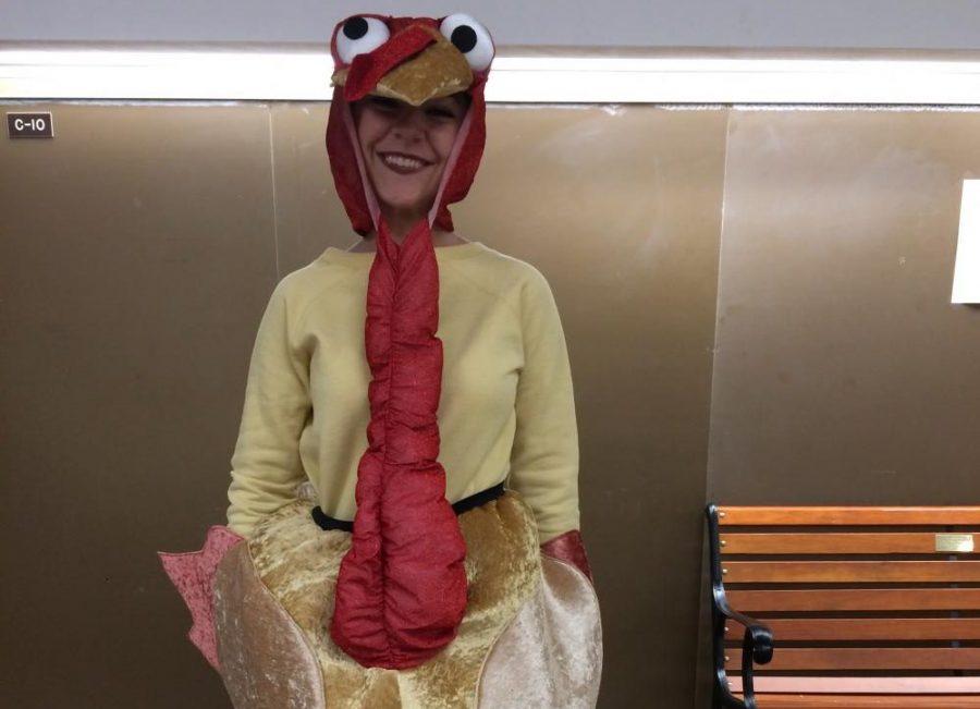NHS+member+Kaitlyn+Landis+demonstrates+how+cute+the+turkey+is.
