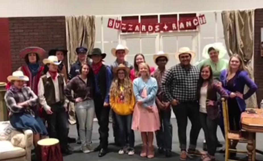 The cast of Girl Crazy poses in front of the set.