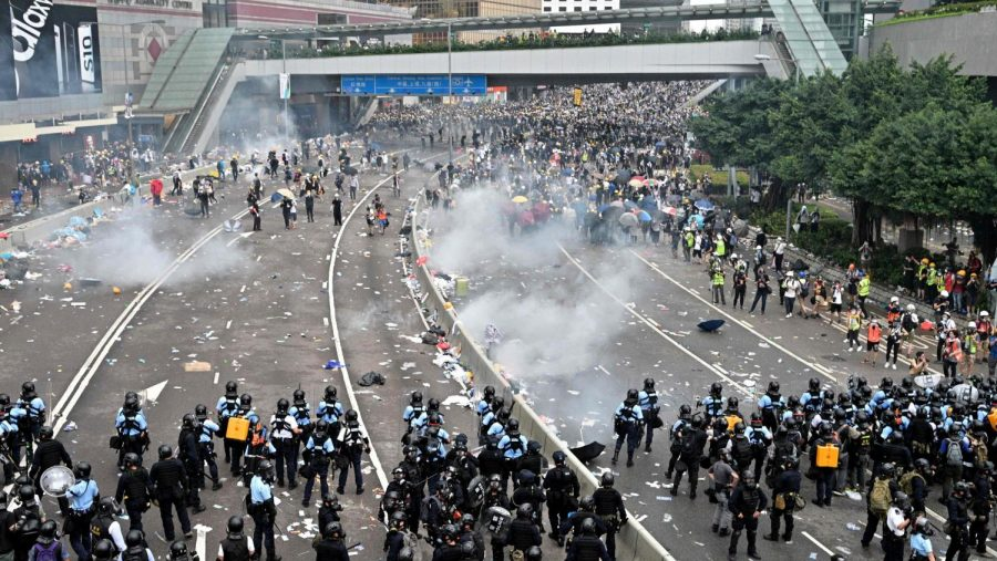 Protests+and+riot+police+clash+on+highways%2C+with+tear+gas+being+thrown+into+the+crowds+by+the+police.