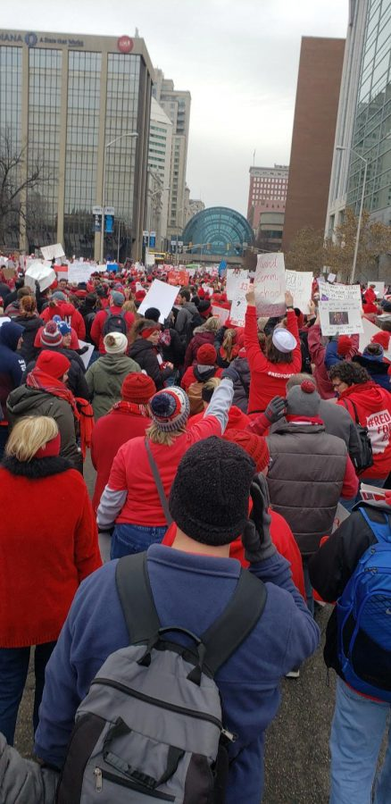 Protester+in+Indianapolis+walk+to+demand+more+funding+for+schools.+Indiana+is+the+lowest+state+in+the+nation+for+increase+in+teachers+raises.