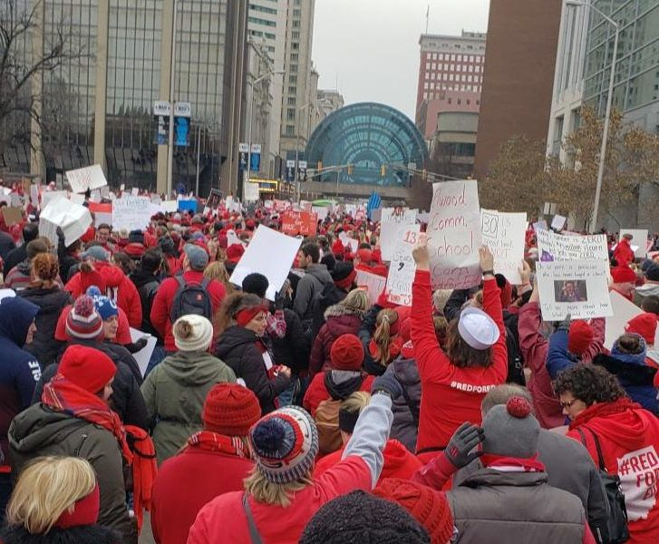 Protester in Indianapolis walk to demand more funding for schools. Indiana is the lowest state in the nation for increase in teachers raises.