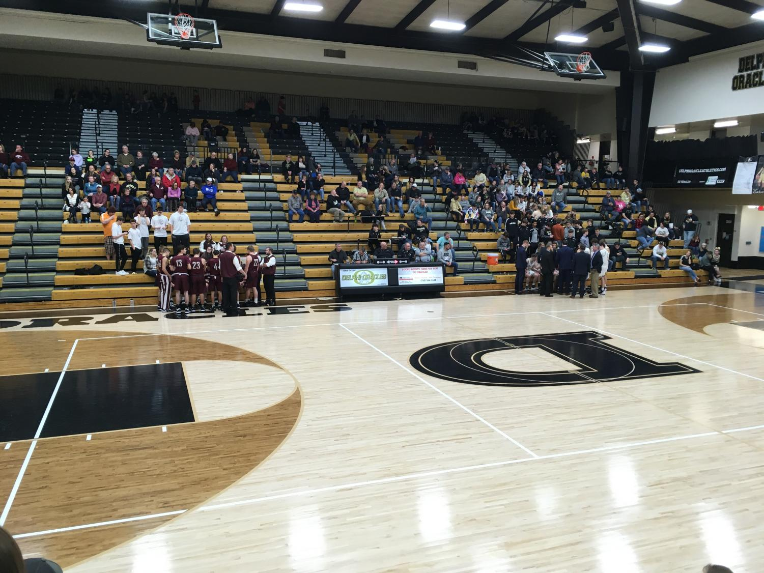 Delphi and Winamac teams huddle together during a timeout to develop strategies for the last few minutes of play.