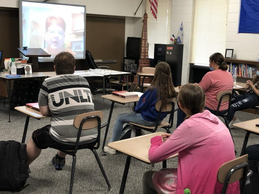 French class participates in reverse extended learning