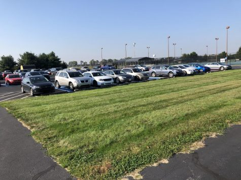 Cars sitting in the student parking lot.