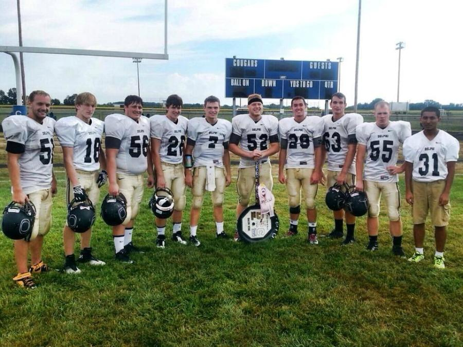 Seniors of the Oracle football team gather around a hard-earned skillet.
