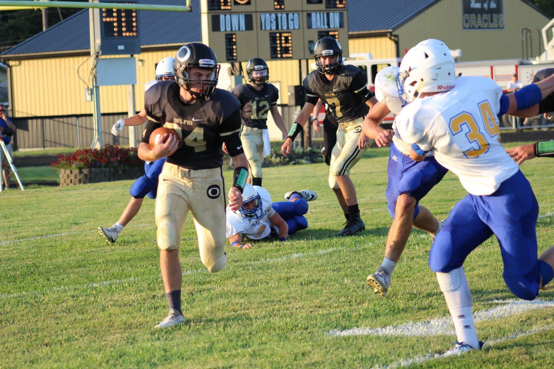 Sophomore running back Jayden McClain turns the corner against Tri County.
