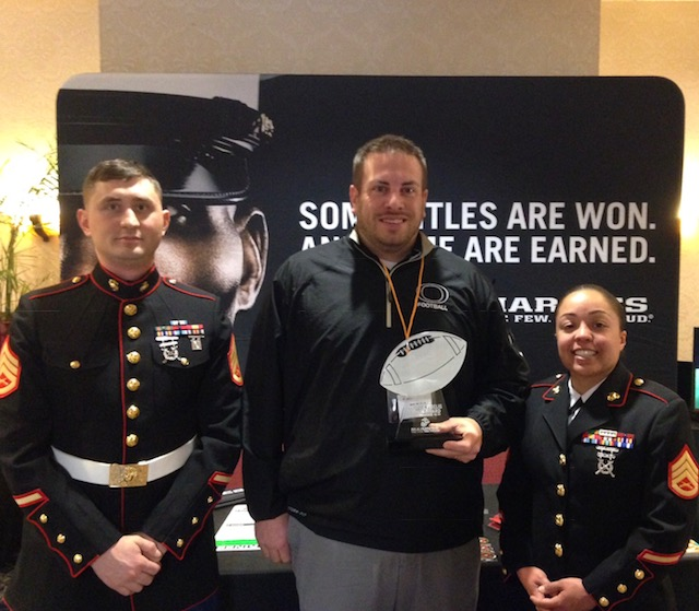 Delphi football coach Josh Strasser receives Semper Fi award in Indianapolis.
