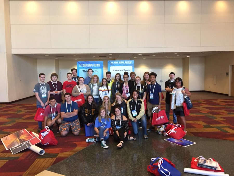 Students pose for a group photo at the NBM Show in Indianapolis.