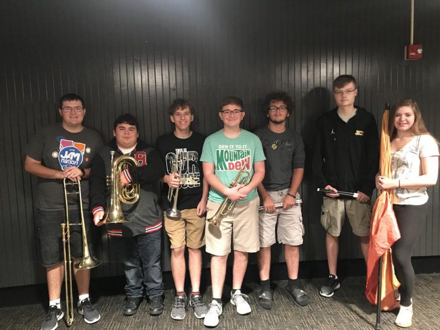 Senior marching band members: (from left) Michael Benner, Israel Villarreal, Mason Swain, Andrew Schoen, Brandon Freeman, Austin Appleton, and Madisyn Jacobs.