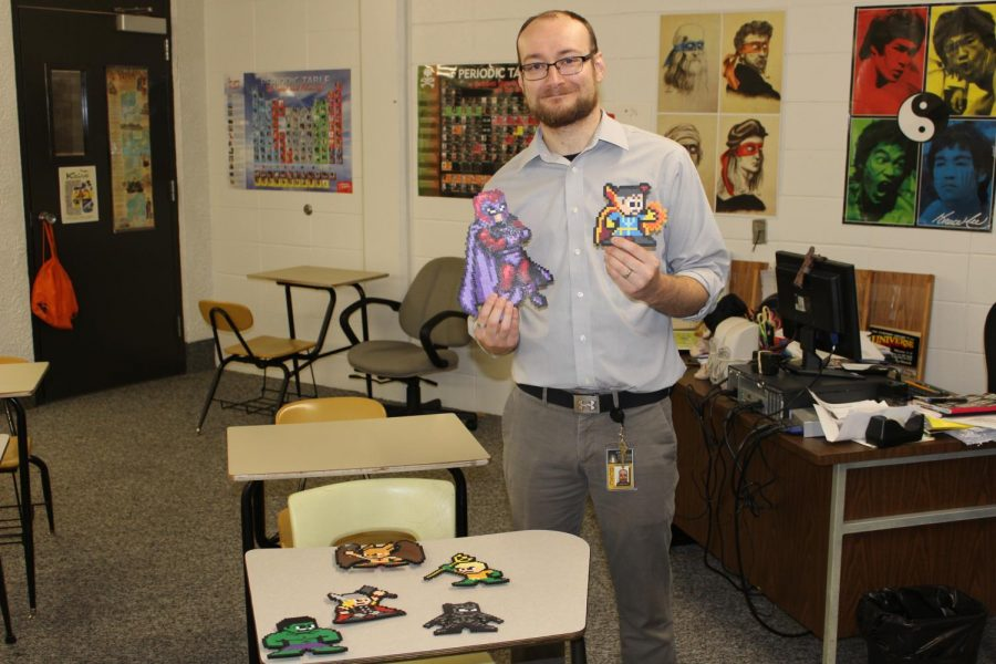 Mr. Gaspar shows off some of his favorite beaded characters.