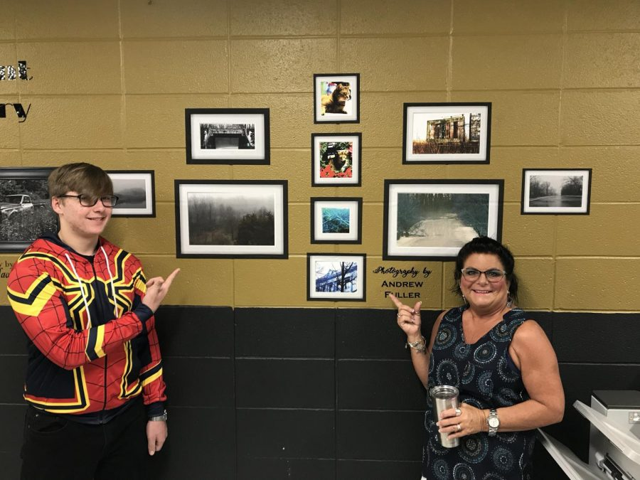 Andrew Fuller, left, and Mrs. Brummett showcase some of Andrews work, located in the graphic design wing.
