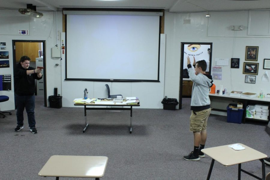 The criminal justice students practice in a drill.