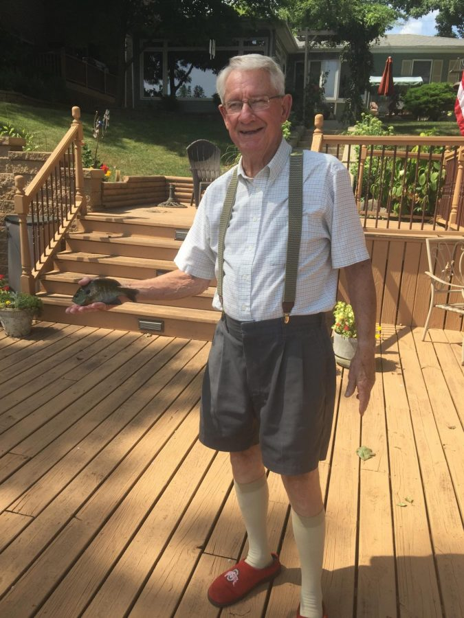 Picture of my grandpa, who was forced to take this picture after he caught a bluegill.