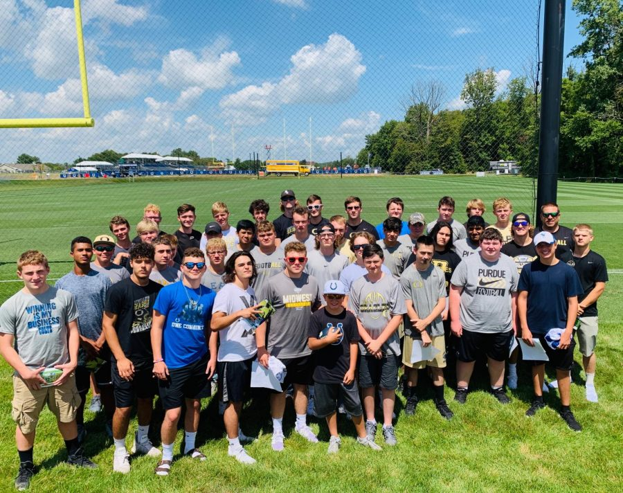 The Oracle football team poses for a picture at the Colts practice facility.