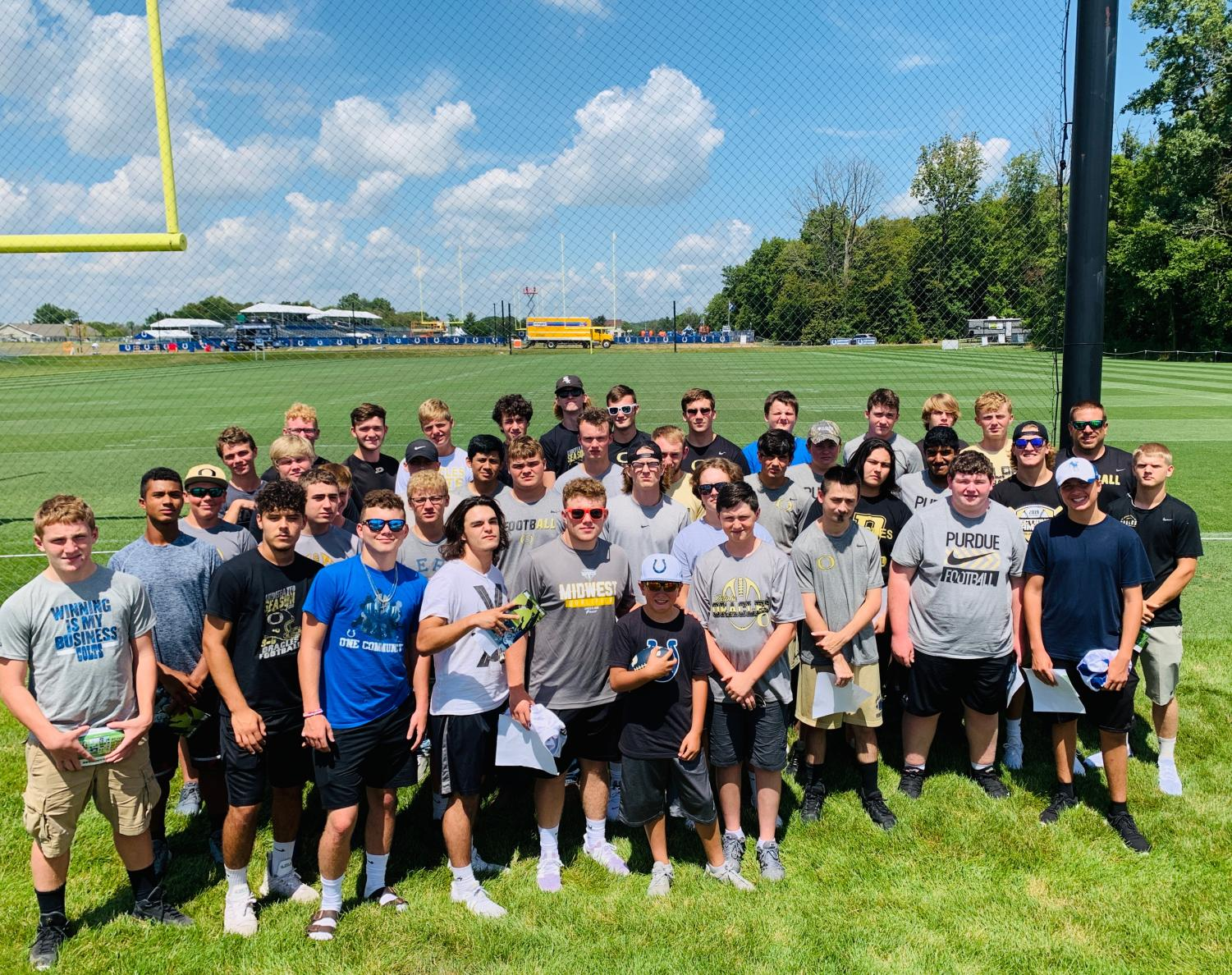The Oracle football team poses for a picture at the Colts' practice facility.