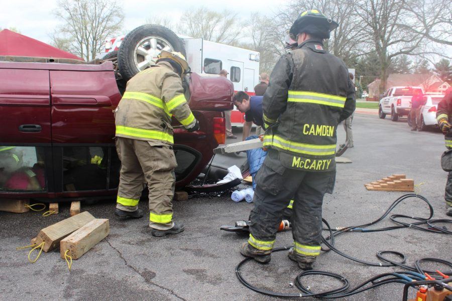 Students watch as the Every 15 Minutes program is performed. Students were able to witness a mock car crash, with mock fatalities and local emergency crews responding, as a way to inform students about the dangers of driving under the influence.