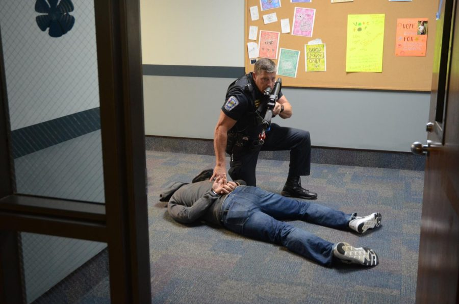 A Carroll Country law enforcement officer trains during an active school shooter training. The training was held at Carroll Elementary School for CCSC staff and Carroll County law enforcement.