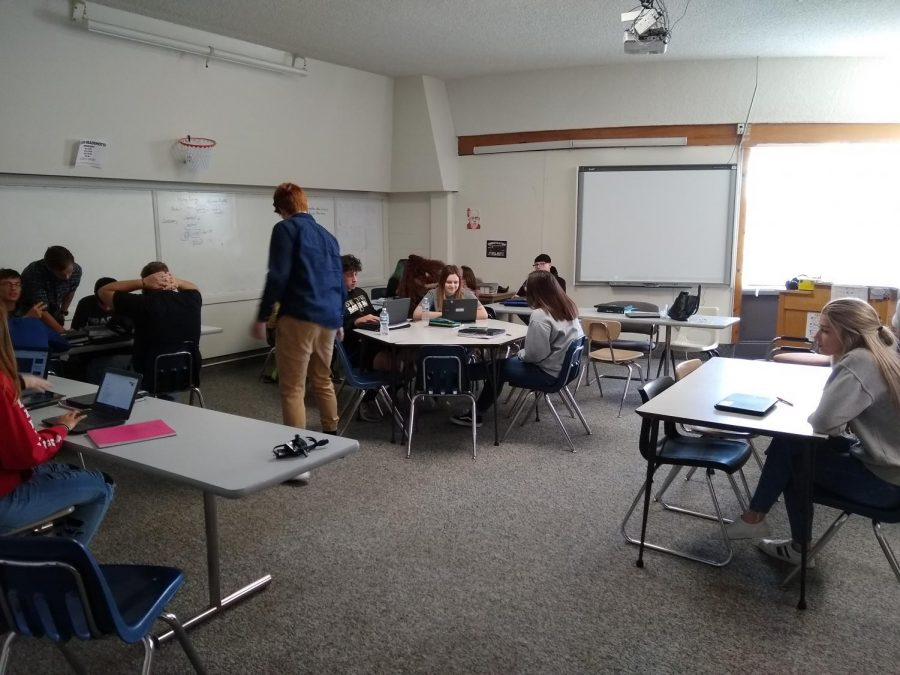 Mr.+Tonsoni%27s+classroom+setup+allows+for+a+more+collaborative+discussion.+Students+work+in+groups+at+tables%2C+which+allows+for+a+learning+experience+not+often+had+in+the+academic+realm.