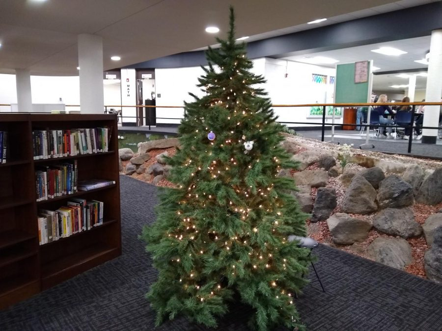 The ornaments submitted in the competition will be placed on this tree in the library. Head to the LMC to receive your free bulb to decorate!