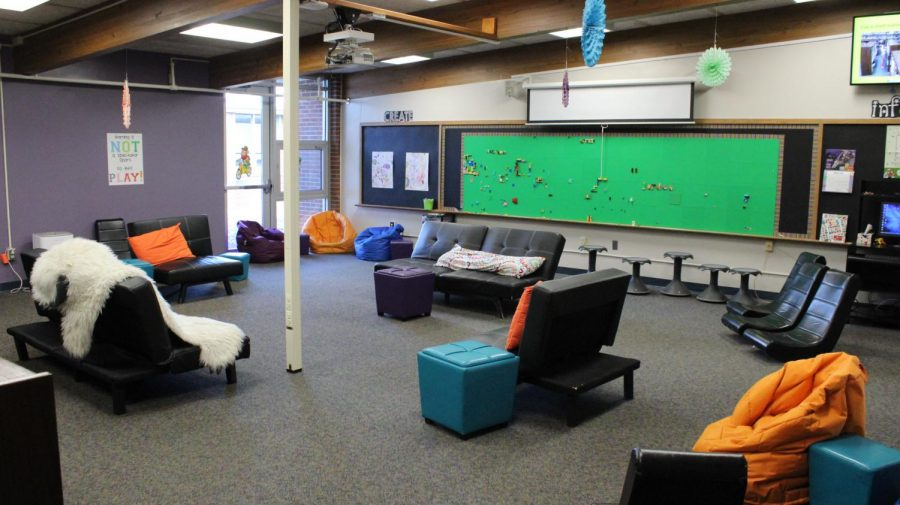 The library has evolved, and is now more than just books. Its features include a LEGO wall, comfortable seating, and various computer stations.