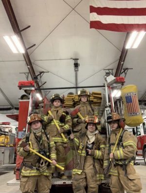 Delphi's fire department cadets lined up in front of one of the fire trucks. Top row left to right: Tyler Bishop, Micah Lawless. Bottom row left to right: Cason Bishop, Eli Bender, Cameron Brown